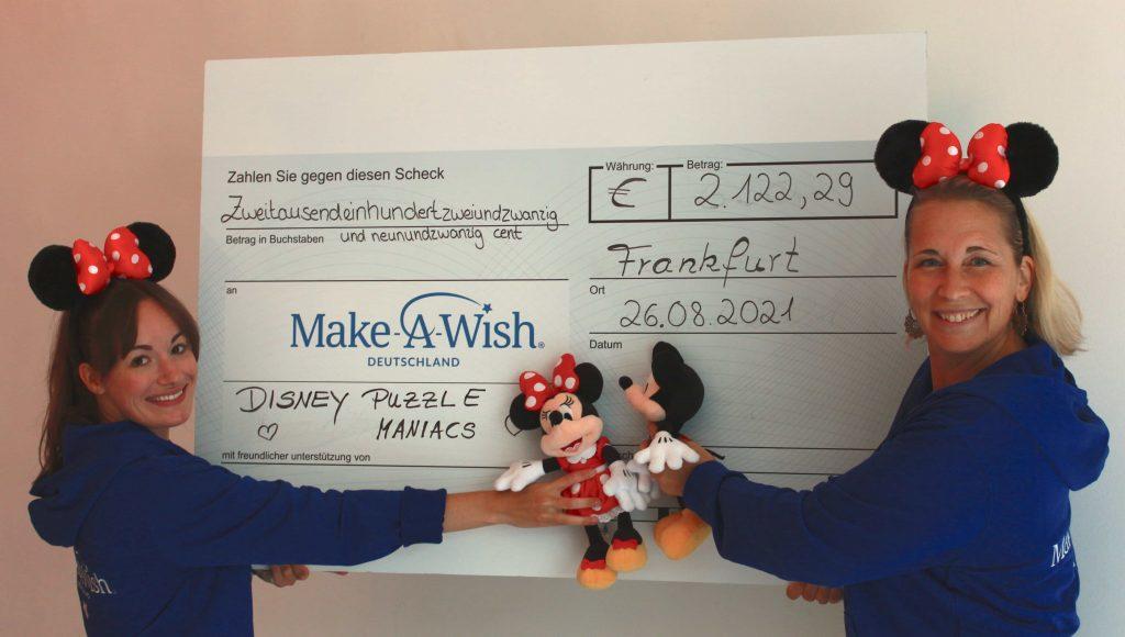 Make-A-Wish-Deutschland-Aktuelles-Scheckbild-Disney-Puzzle-Maniacs